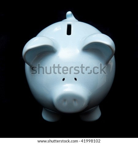 Blue piggy bank money box black studio background. - stock photo