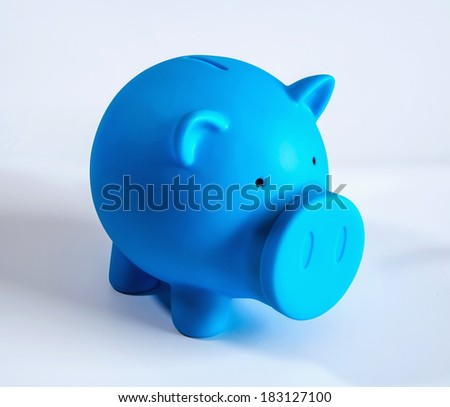 Blue piggy bank on white isolated background