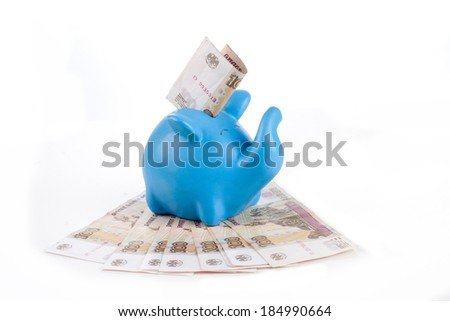 blue piggy bank with bills hundred rubles on a white background
