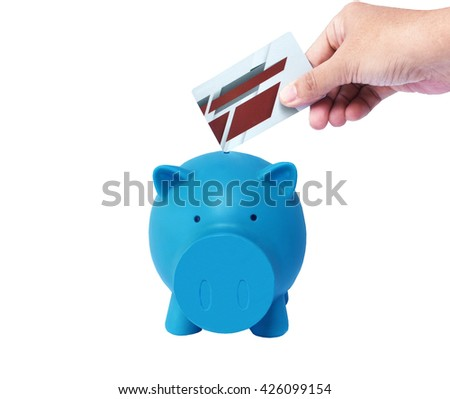 Blue Piggy bank with coins and credit card isolated on white background