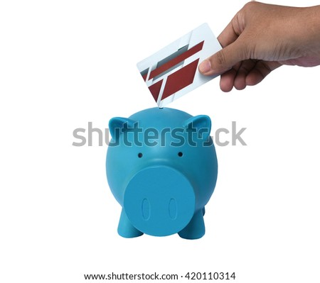 Blue Piggy bank with credit card isolated on white background