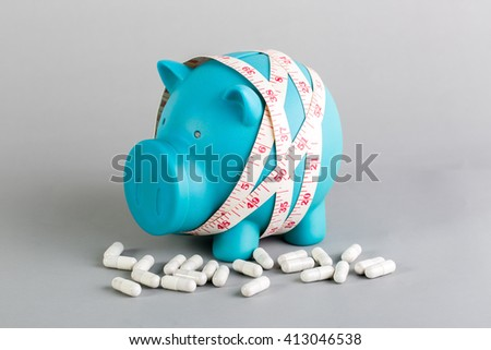 blue piggy bank with diet supplement for diet concept - stock photo