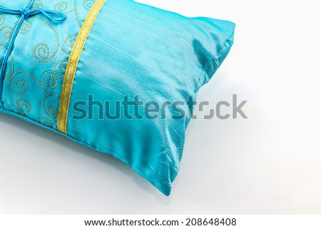 Blue pillow on white background. - stock photo