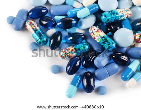 Blue pills isolated on white - stock photo
