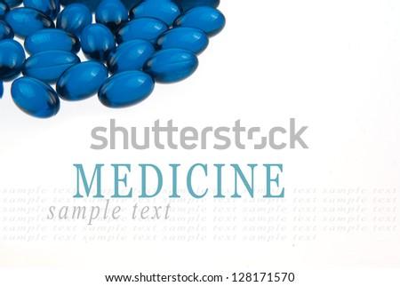 Blue pills isolated on white background - stock photo