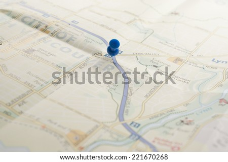 Blue pin on the map  - stock photo