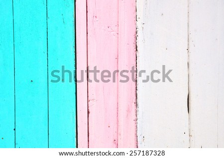 Blue, pink and white wooden background with vertical stripes. Vintage old backdrop. Pastel color. - stock photo