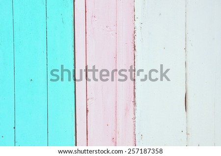 Blue, pink and white wooden background with vertical stripes. Vintage old backdrop. Pastel color. Vintage effect. - stock photo