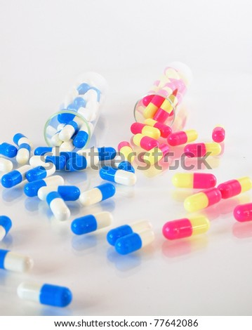 blue & pink capsules and containers