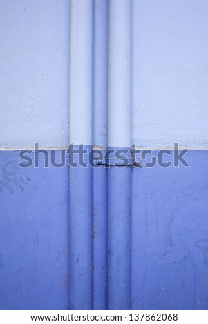 Blue pipes in the structure of a building, installation and supply - stock photo