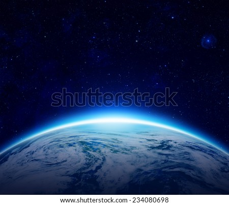 Blue Planet Earth sunrise over cloudy ocean with stars in the sky, An eclipse of the Sun by the world make rising sun in space can use for background - Elements of this image furnished by NASA - stock photo