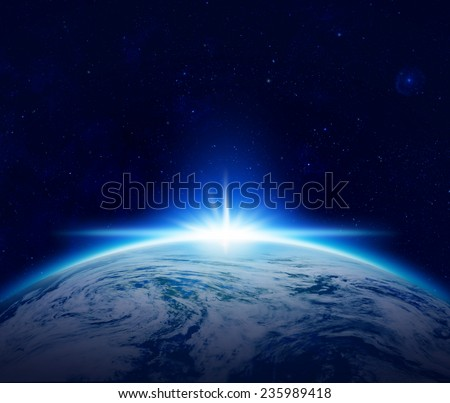 Blue Planet Earth sunrise over cloudy ocean with stars in the sky, An eclipse of the Sun by the world make rising sun in space - Elements of this image furnished by NASA - stock photo