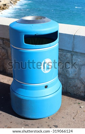 Blue Plastic Bin in the city of Nice in France - stock photo