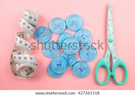 Blue Plastic Buttons on Pink Background.