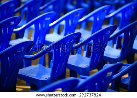 blue plastic chairs - stock photo