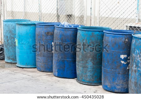 Blue plastic containers in a row for separate garbage collection.