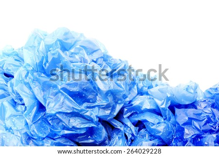 Blue plastic garbage bags with water drops - stock photo