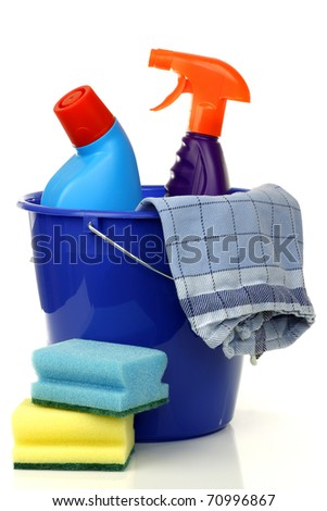 blue plastic household bucket with two cleaning bottles, a household towel and some cleaning pads on a white background - stock photo