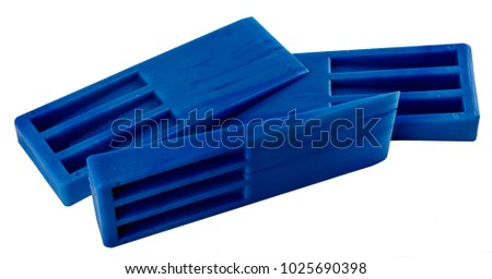 Blue plastic molding wedges stacked on side view