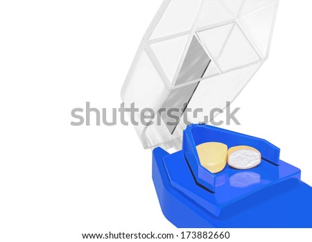 Blue plastic pill cutter with sharp blade, clear hinged cover. Cross section of tablet cut in half. Isolated on a white background. Horizontal view.  - stock photo