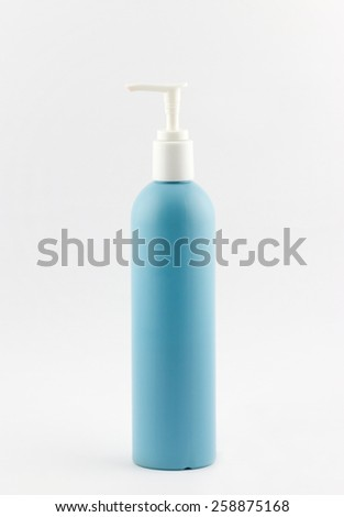 Blue plastic tubes of shampoo with batcher on white background - stock photo