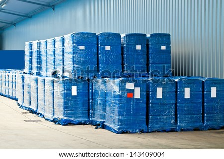 Blue plastic wrapped packets in a warehouse store - stock photo