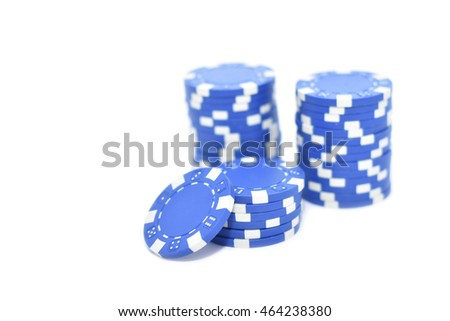 Blue poker chips isolated on white
