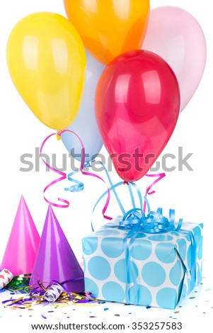 Blue polka dot present with birthday hats and balloons on a white background