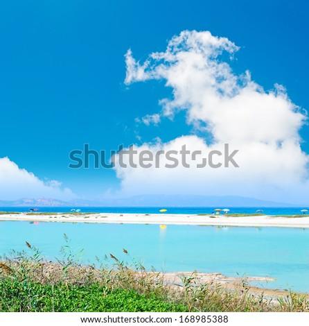 blue pond by Stintino sea - stock photo