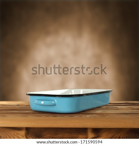 blue pot and brown interior for text  - stock photo