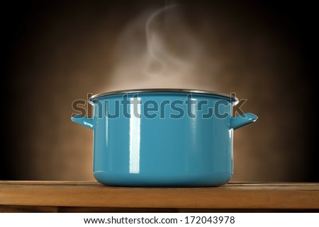 blue pot and smoke on brown background  - stock photo