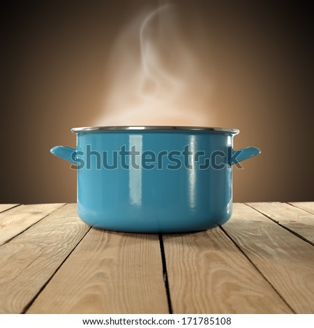 blue pot of hot food  - stock photo
