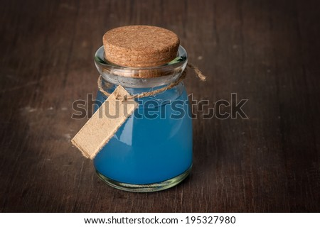 blue Potion in a bottle - stock photo
