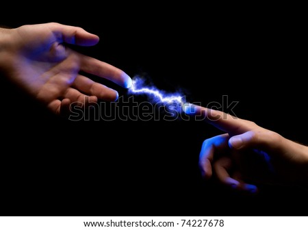 blue powerful electric spark between two fingers of mans hands on black background - stock photo