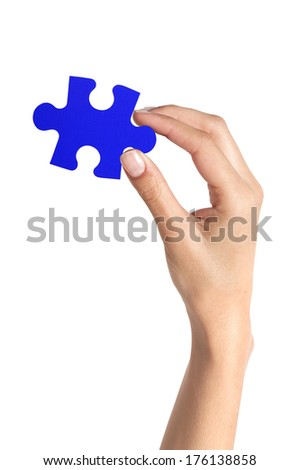 Blue puzzle in woman hand isolated on white background - stock photo