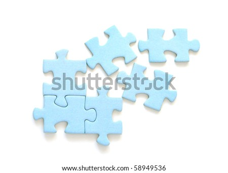 Blue puzzle pieces on white background - stock photo