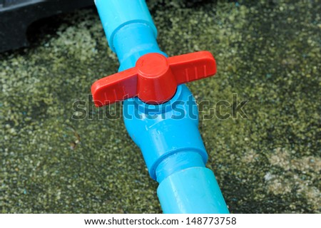 blue pvc pipe connection with valve - stock photo