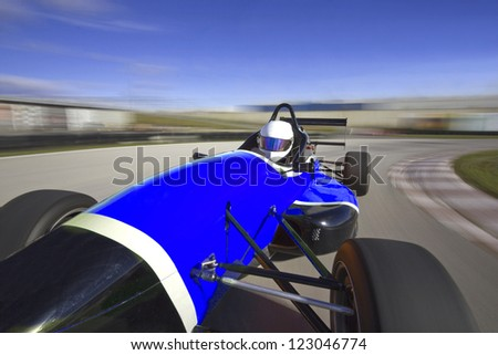 blue racing car driving at high speed in circuit.Camera on board - stock photo