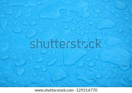 blue rain puddles - stock photo