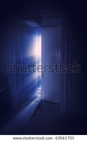 Blue rays of light behind the door