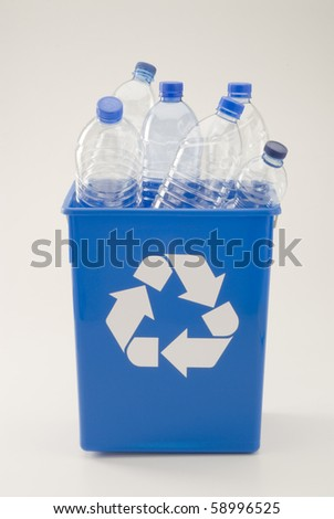 Blue recycling bin full of pet plastic bottles. White background. - stock photo