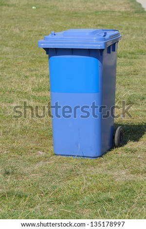 blue recycling box on grass in Germany