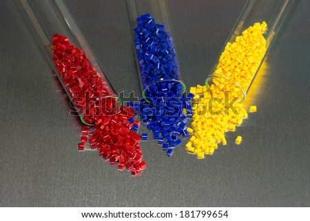 blue, red and yellow polymer resin in laboratory on metal plate - stock photo