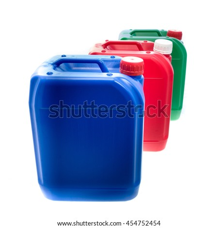 Blue red green plastic canisters, containers; isolated on white background  - stock photo