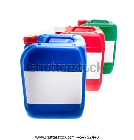 Blue red green plastic canisters, containers with label ;your text here; isolated on white background  - stock photo