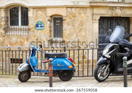 Blue retro scooter parked on Paris street - stock photo
