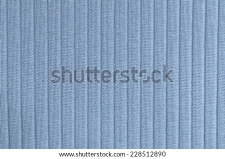 Blue ribbed knit fabric in full frame - stock photo