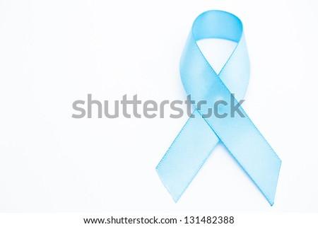 Blue ribbon for prostate cancer on white background - stock photo