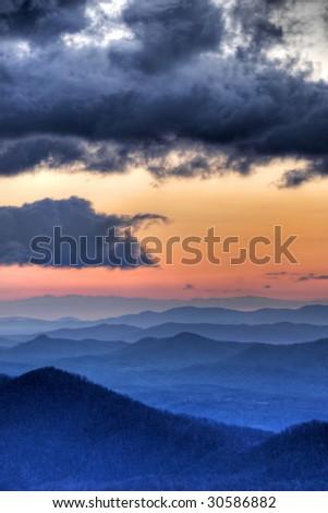 Blue Ridge Mountains at sunrise with dramatic skies - stock photo