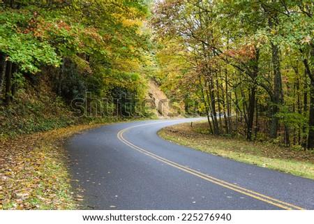 Blue Ridge Parkway in North Carolina's Nantahala National Forest with vibrant fall colors. - stock photo
